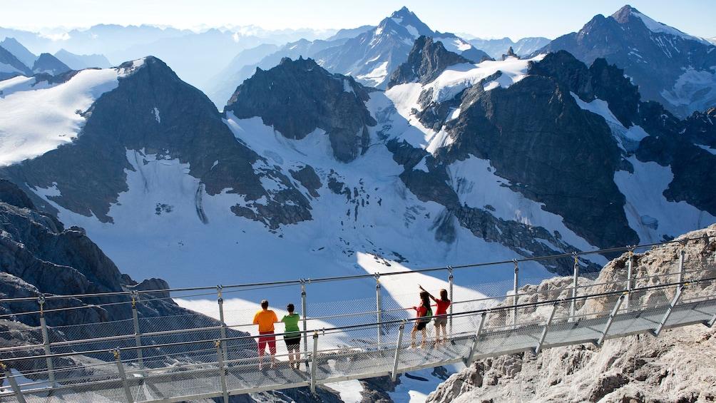 Tour group on the Cliff Walk bridge on Mount Titlis in Switzerland