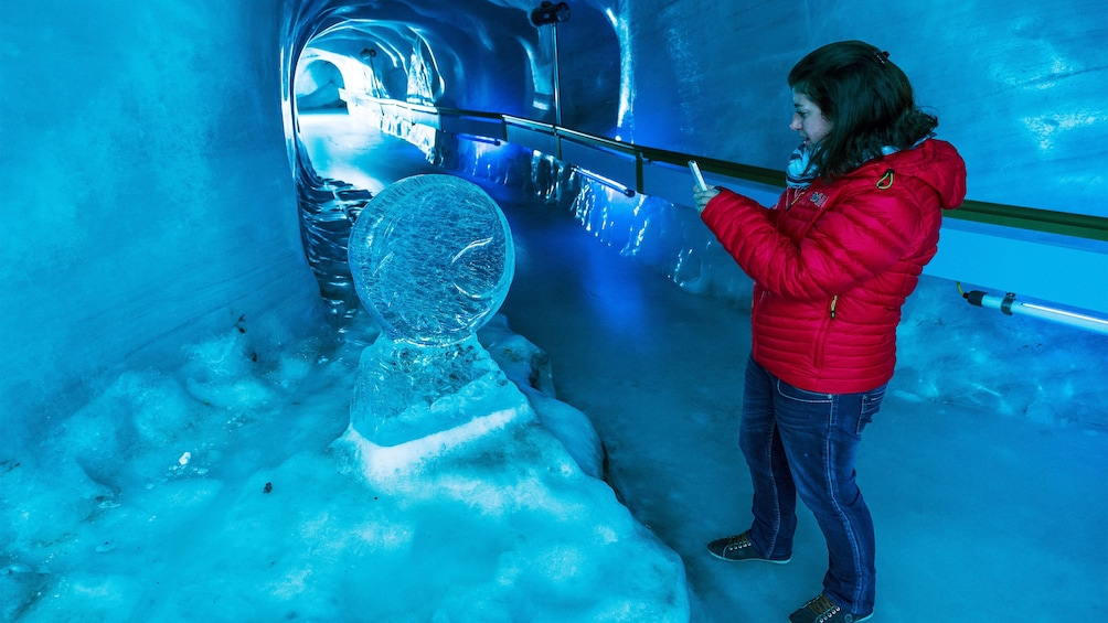 Woman in the glacial tunnel of the Ice Grotto on Mount Titlis in Switzerland