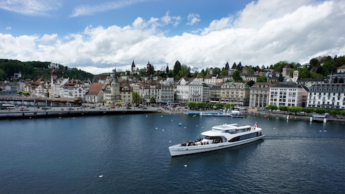 Tour boat with the city in the background in Lucerne