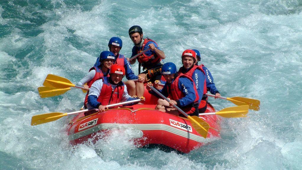 People on a raft navigating some rapids in Antalya