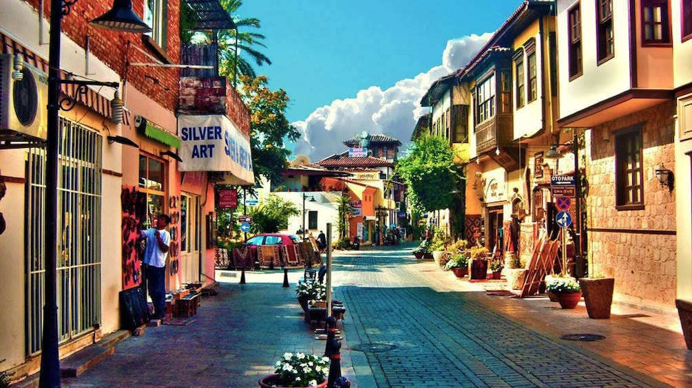Show item 1 of 5. Storefronts lining cobblestone streets in Antalya