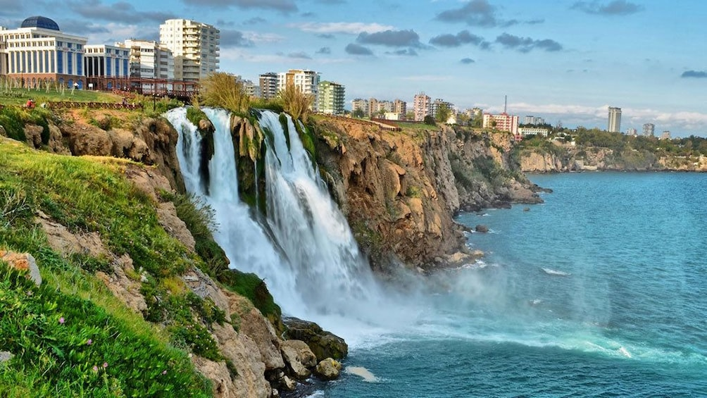 Show item 4 of 5. waterfalls pouring into the sea off the coast of Antalya