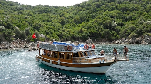People on a boat near the shore of Kemer