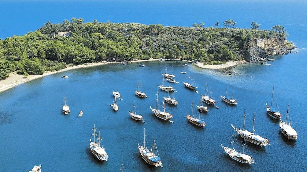 Show item 5 of 5. A group of boats anchored off the coast of Kemer