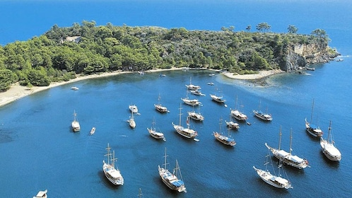 A group of boats anchored off the coast of Kemer
