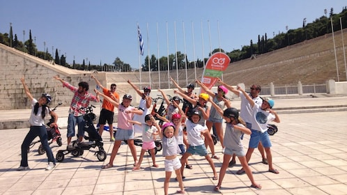 group of kids posing in front of the amphitheater in Athens