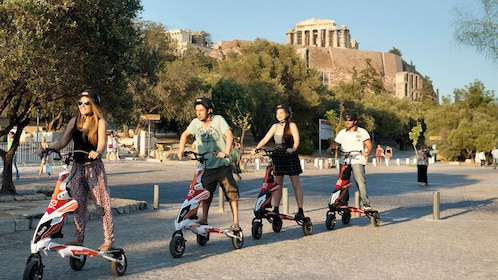 group of electric tri scooter riders near the Acropolis in Athens