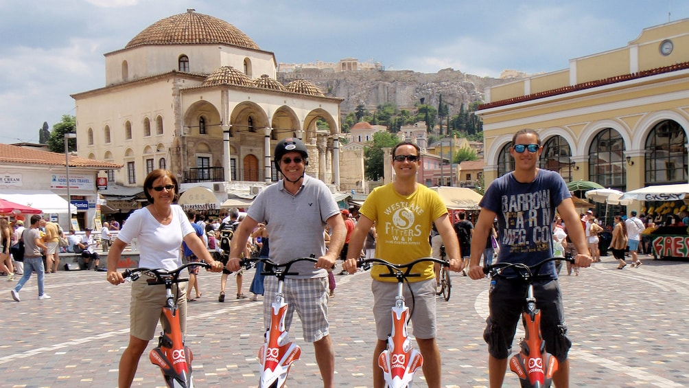 Show item 1 of 5. group on electric tri scooters exploring the city of Athens
