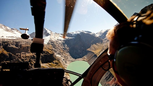 helicopter passenger wearing headphones during the flight in New Zealand