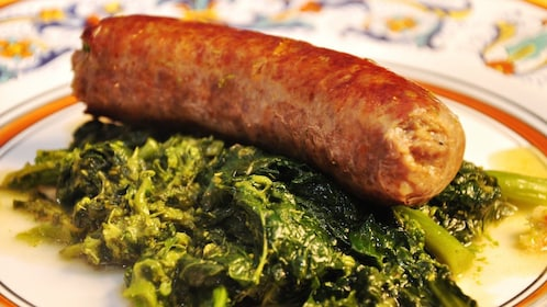 Italian sausage on a bed of broccoeltte