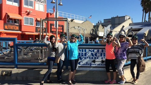 friends posing at muscle beach