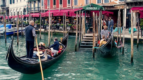 visitors riding the gondolas in Venice
