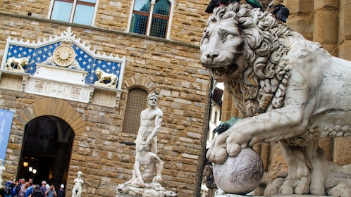 sculpture of a lion outside of a stone building in Florence