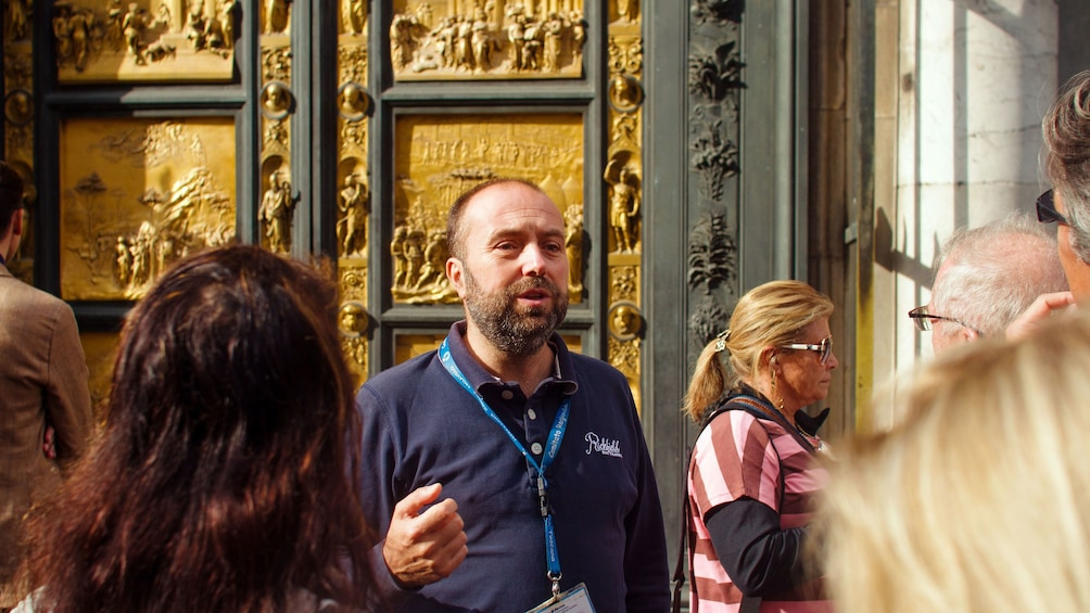guide navigating visitors around historical sites in Florence
