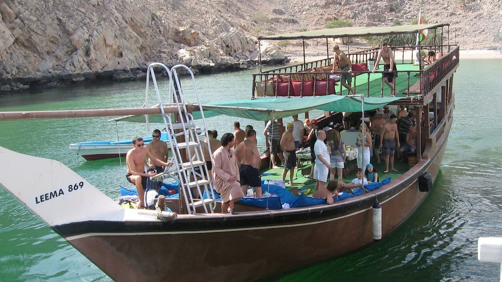 Tourists board a cruise boat in the Indian Ocean