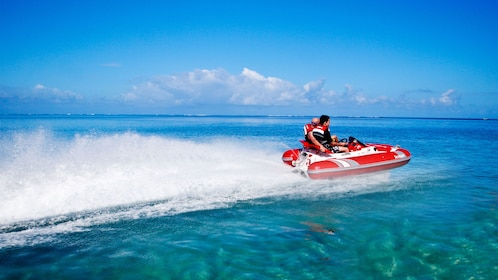 Couple riding a Sea Kart in the Mauritius lagoon