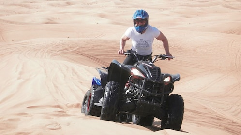 Man on an ATV in the sand dunes near Cape Town, South Africa