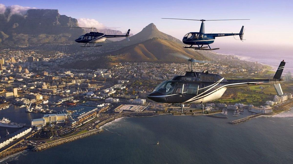 three helicopters flying towards the city in Cape Town