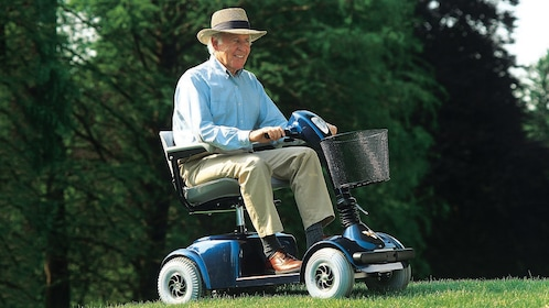 Elderly man riding a scooter