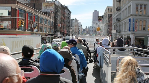 Tourists board a double decker bus to see NYC