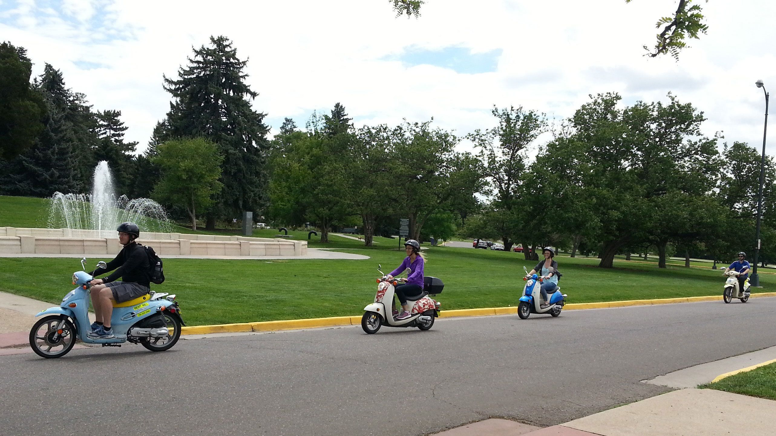 Tourists exploring Denver via scooter