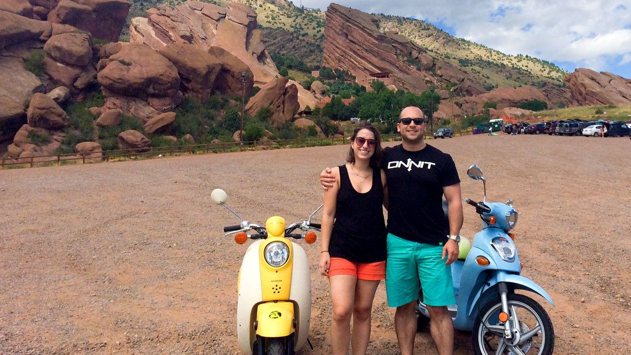 Couple embarking on a scooter tour around Denver