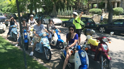 Tour group ready to embark on a scooter tour