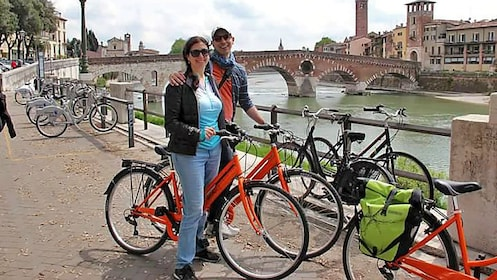 Couple touring through Verona on bike