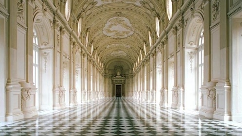 Long checkered hallway of the Galleria Grande in the Palace of Venaria in Turin