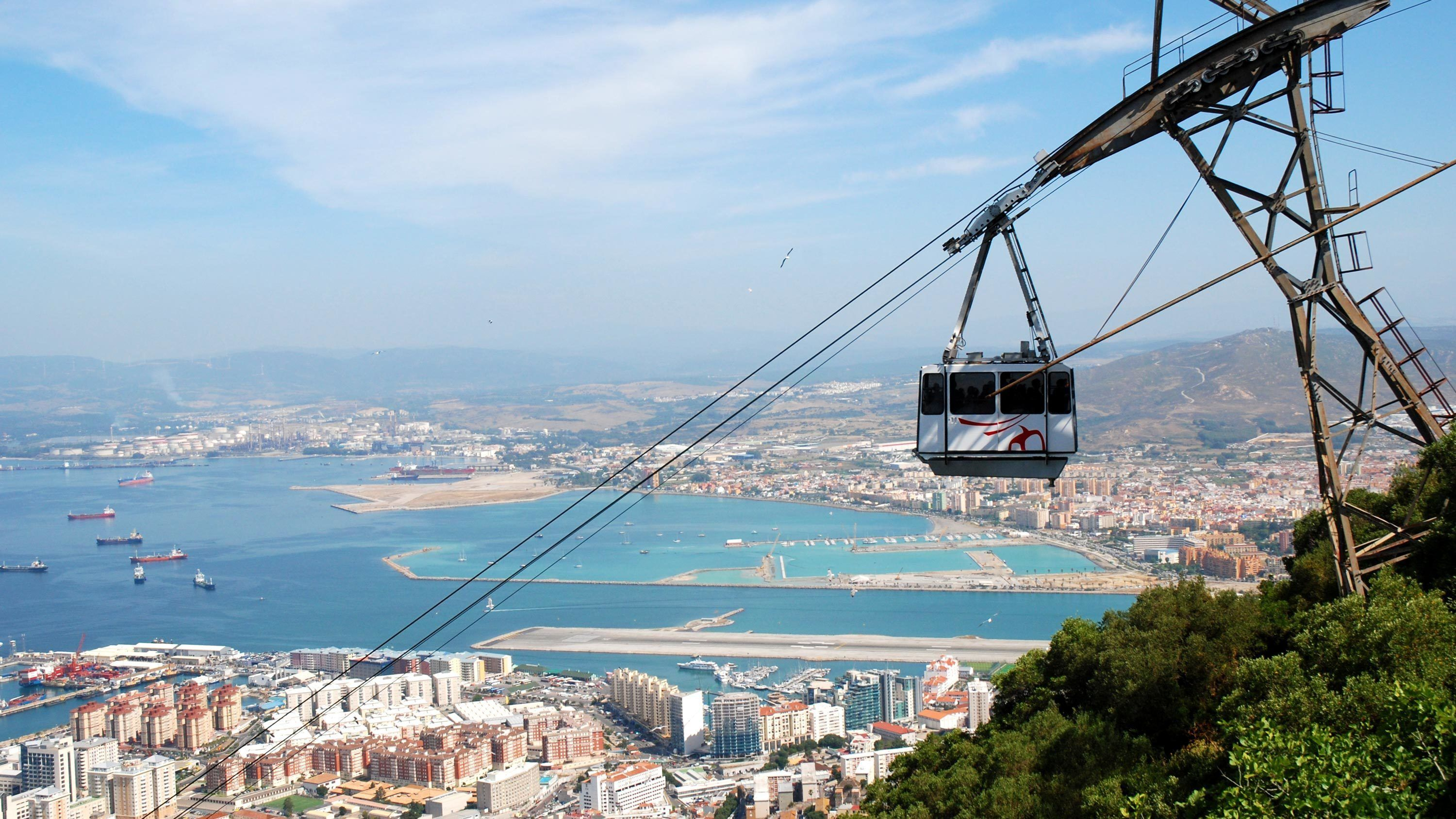 Cable car climbing high over the city in Gibraltar