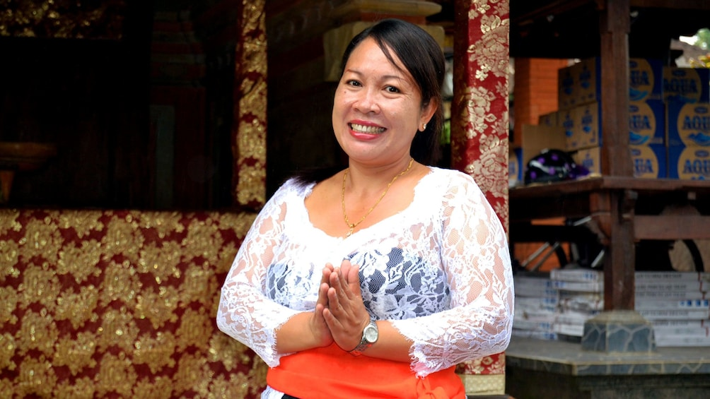 Show item 2 of 5. Smiling instructor in Balinese cooking class in Bali