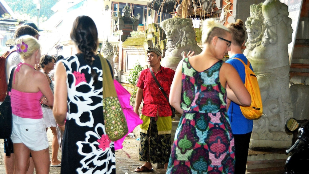 Show item 3 of 5. Tour group at a market in Bali