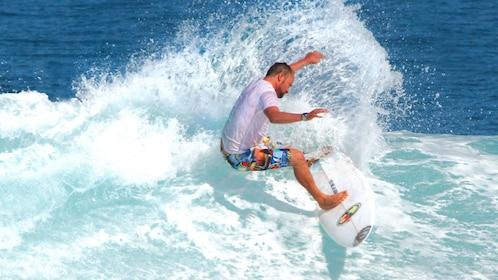 Surfer in the water in Kuta