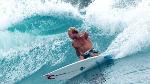 Surfer on a wave in Kuta