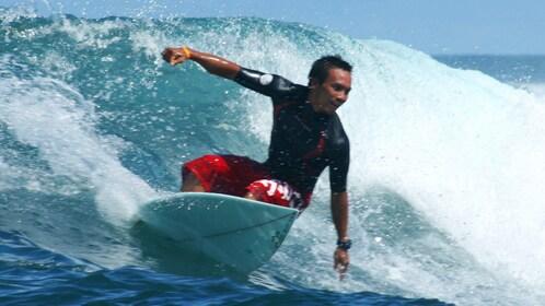 Man catching wave in Kuta