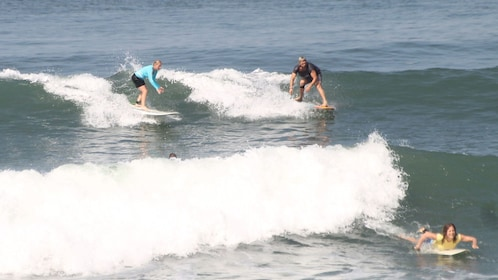 Group of surfers in the water in Kuta