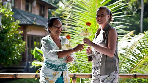 Pair of women with flowers in Gulingan Village