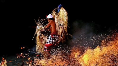 Fire dancer performing onstage in Bali
