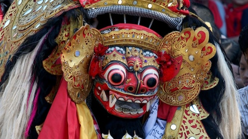 Ornamental mask in a traditional Barong dance performance in Bali