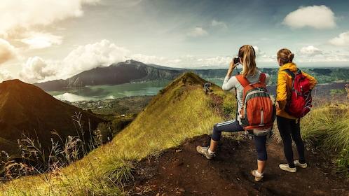 Hiking pari of women on Mount Ijen in Bali
