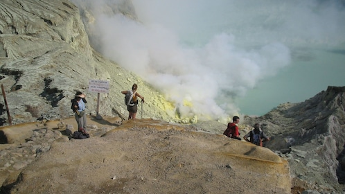 Hiking group near volcanic crater on Mount Ijen in Bali