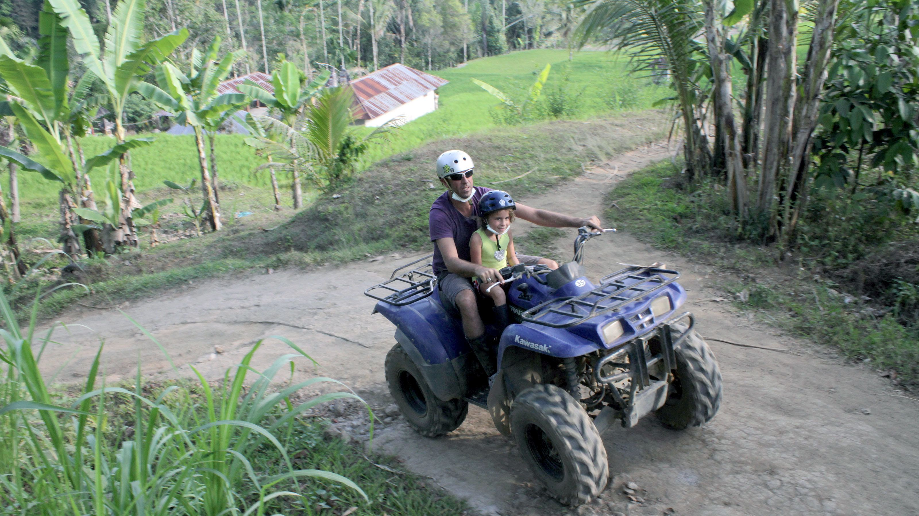 Father and daughter on a quad in Bali