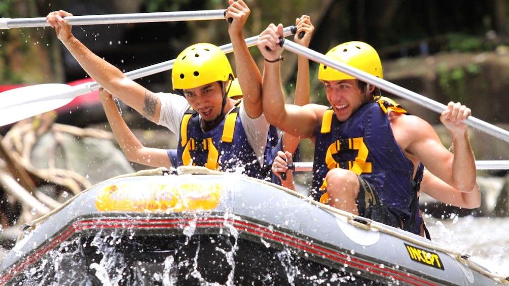 Tampilkan item 1 dari 5. White water rafters battling strong currents in Bali