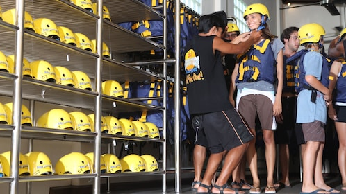 Group getting fitted with white water rafting equipment in Bali
