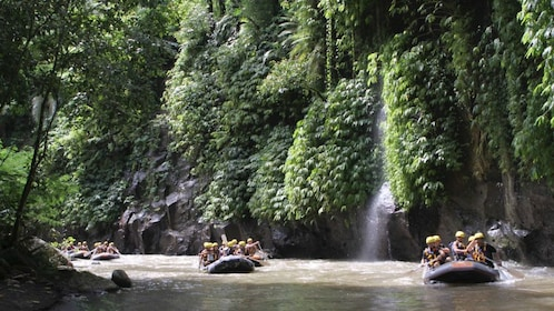 Group of white water rafters setting out in Bali