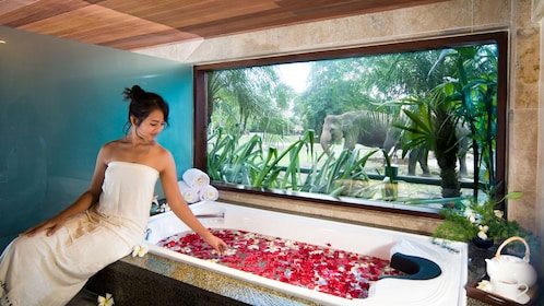 Soaking in a flower peddle bath at the spa in Bali