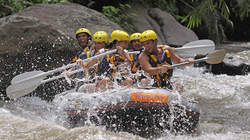 White water rafters fighting the strong current in Bali
