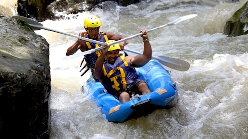 Rafters racing down a river in Bali