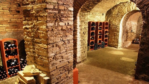 Brick columns and archways in a wine cellar in Rome