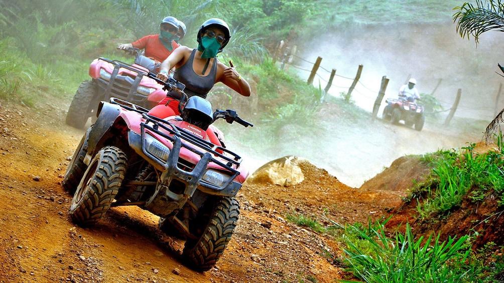 Show item 1 of 10. ATV riding group on a dirt path in Puerto Vallarta